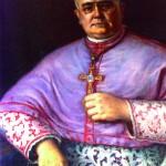 Portrait de mgr Patau avec la croix en Grenat.