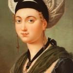 Arlesienne aux boucles fileuses, coll. Costa, Grasse, publié dans O.Pascal, Costume d'Arles.