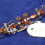 Broche en or, grenat de Perpignan et perles , vente aux encchères à Nimes le 11-02-2011