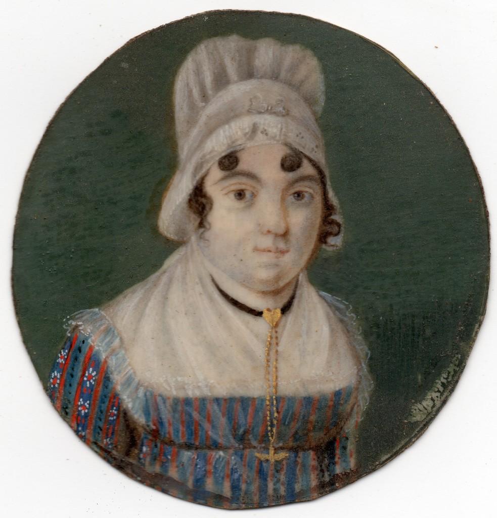 Portrait de jeune femme en coiffe et portant un pendantif en forme de Saint-Esprit.