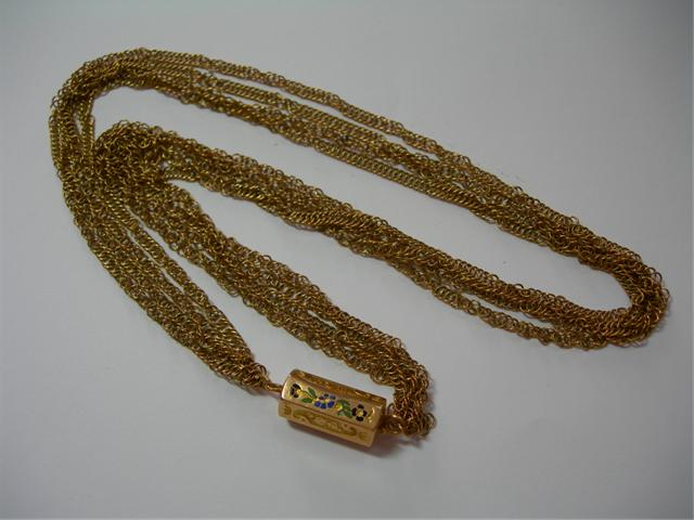 Collier or jaune, vente à Nîmes, aout 2009.