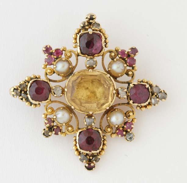 Broche avec citrine, grenats, perles et diamants taille rose.