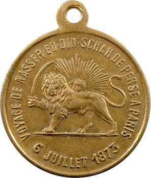 VOYAGE DE NASSER ED. DIN. SCHAH DE PERSE A PARIS// 6 JUILLET 1873. Le lion d'Iran tenant une épée de la patte droite ; derrière lui, un soleil rayonnant.  Bronze. 4,90 g. 23,0 mm.